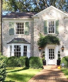 This house! We love it all - the whitewashed brick the vine reaching over the front entry the lanterns and those green shutters! This Old House, Style At Home, Exterior Colors, Exterior Design, Green Shutters, Exterior Shutters, New England Homes, Cabana, Home Fashion
