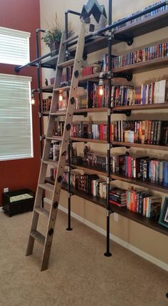Home library shelves ladder 48 Ideas for 2019 Pipe Bookshelf, Floor To Ceiling Bookshelves, Library Shelves, Bookshelf Design, Book Shelves, Dyi Bookshelves, Bookcases, Industrial Pipe Shelves, Industrial House