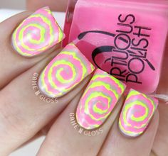 Awesome neon pink and yellow neon swirl nail design on a nude base - great for summer! - IG @GameNGloss
