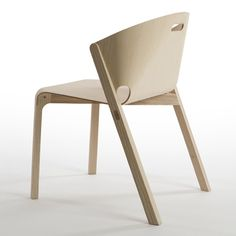 Industrial designer Benjamin Hubert's latest chair features a T-shirt-shaped piece of plywood curled smoothly into its solid ash frame.