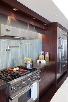 Having a pot filler faucet right over your stove makes things really easy and convenient. Definitely something to keep in mind for your future kitchen remodel. Looking for more home inspiration? We pin the best @Dianna Williams