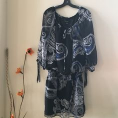 White House Black Market Top Black, white and blue tunic .Elastic at the waist, sheer 3/4 sleeves. Ties at the collar. Excellent condition and super quality in this designer top. White House Black Market Tops Tunics