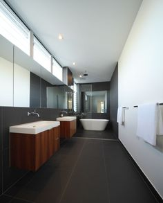 Love the panel effect of the mirrors and wet area with the freestanding bath.