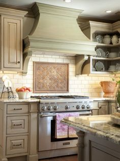 french country hoods | Traditional kitchen hood with arched lines, clean angles and well ...