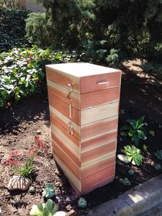 Build your own modern mailbox using planks of redwood. Design Intervention Diary.Com