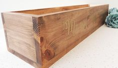 Rustic wedding wooden planter with personalisation. This is a large sized wooden weddding table planter. It acn be personalised with and names or any wording of your choice. The piece makes a lovely display at the top table and can be filled with flowers, jars, candles or any other