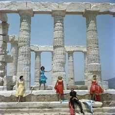 Slim Aarons - 1961—Dimitris Kritsas, a fashionable young couturier, poses among the gleaming Doric columns of the temple to Poseidon at Sounion.