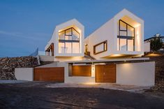 Two gable roofs give the street a distinct look A Bird's Eye View of Budapest: Hilltop House with Twin Gable Roofs