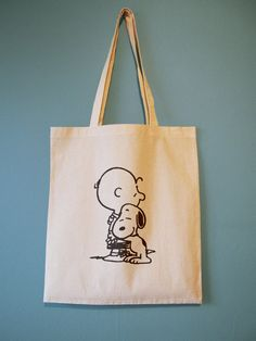 Snoopy Hugging Charlie Brown Natural Cotton Tote Bag or by BYKI