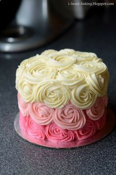 Pink ombre rose cake. Really easy and looks amazing as you only need one food colour! Put just a couple of small drops in the buttercream for the lighter shade and double the amount for the darker pink. Experiment with different colours - blues or purples would look great! Good luck! #baking #ombre #cakes