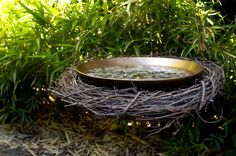 Make a hanging birdbath -  ** MATERIALS **   •18-inch dried grapevine wreath, with 12-inch opening  •Shallow, watertight bowl, such as pottery or glass, that fits inside the wreath  •3 lengths medium-weight (such as 20-gauge) copper wire, each 10 feet long  •3 to 4 cups small stones, as necessary
