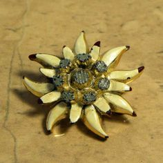 This pretty Edelweiss vintage flower brooch pin is from St Wolfgang in Austria A smaller Edelweiss brooch in cream gold and silver colors Signature on