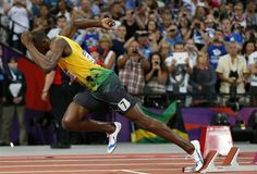 Day 13: Evening Session - Track & Field Slideshows | Usain Bolt at the evening session of track and field at Olympic Stadium. (Photo: Matt Dunham / Associated Press) #NBCOlympics