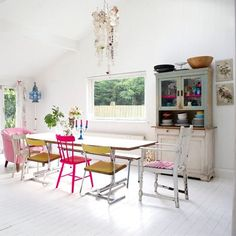 Dining Room Decorating Ideas: White floor and walls with brightly coloured furniture and accessories An all white space can be livened up with a dash of neon. A hit of the unexpected will always provide a talking point. redonline.co.uk