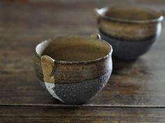 Black sandstone tea bowls by Kambe Chinatsu at Oli Oli