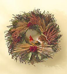 """Rooster Wreath . $49.95. Rooster Wreath. Greet guests with a blend of scented botanicals and natural accents that stimulates the senses and enhances your dcor. Crafted in Mexico over a natural twig base, it layers natural leaves with natural black beard wheat, red feverview, green caspia and red broom corn and is crowned with a faux feather rooster perched atop a sheaf of natural wheat. Size Approx 16"""" dia. Shipping Please allow 3-4 weeks for delivery."""