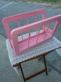 Pink wood magazine rack