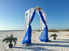 Charming Tide Package Destination Beach Wedding White Arch Blue And Orange