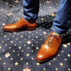 Men's Fashion Look: Brown wingtips, paisley socks and premium denim jeans. #mensfashion #menswear #wingtips