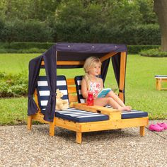 """KidKraft Double Chaise Lounge with Canopy and Cup Holders - Honey & Navy. """"When the weather gets warm, children love to """"""""chill"""""""" under the KidKraft Double Chaise Lounge's three-sided canopy. The high-quality, weather-resistant construction will keep this cute lounger looking good through all the seasons."""". 