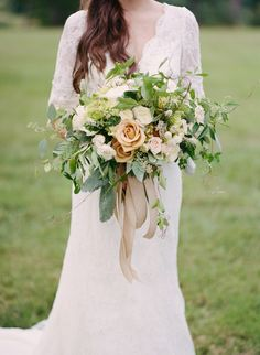 Peach, green and cream bridal bouquet | Kacie Lynch Photography | see more on: http://burnettsboards.com/2014/10/sophisticated-vineyard-wedding/