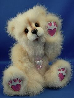 Love Polar Bear by Kathy Myerswho has been a professional Teddy Bear Artist since 1988. She specializes in creating handmade One Of A Kind teddy bears & other animals from vintage mink stoles, coats, & collars / http://www.myminkbears.com