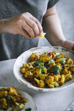 A dry vegan curry from Northern India and Pakistan, this delicious Aloo Gobi is made with stir-frying potatoes and cauliflower with spices.