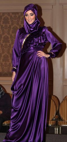 I'm loving this modest royal purple gown with matching hijab.  Stunning!
