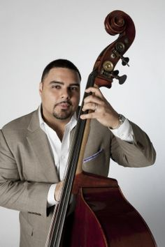 Carlos Henriquez, Bronx-born bassist already recognized Woodlawn's jazz heritage from school field trips he took there. But unlike most of his fellow students at Public School 30, from the age of 14, he was playing at People's Park across the street with Latin jazz greats Tito Puente, Eddie Palmieri and Celia Cruz, whose mausoleum is one of the highlights at Woodlawn│NY Daily News