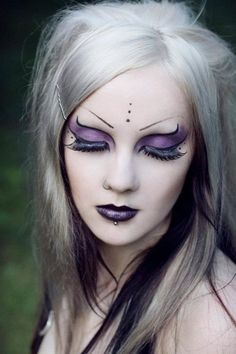 FUCK YEAH GOTHIC MAKEUP ( name of where the look came from) I wonder if her brows are just paled out or are shaved?