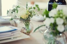 Ivory-and-Green-Beach-Centerpieces- Simple and elegant mixed with the blue mason jars