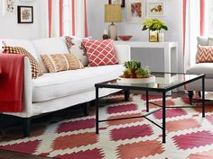 One Living Room, Three Ways : Page 03 : Rooms : Home & Garden Television. Love this rug doesn't overwhelm; red and white LR and the simple sheers with a red stipe.
