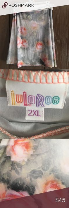 Lularoe Watercolor Azure Beautiful pink and gray silky Azure by LulaRoe. Never worn but tag removed. 2x cleaning out my closet to make room for more. LuLaRoe Skirts