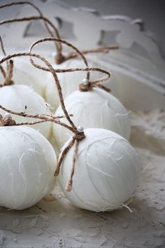 White ornaments, that is just lovely  foam balls, white fabric ripped, florist pins, twine.
