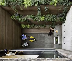 The dramatic 90-square-foot patio features a cooking and seating area. The floor and countertop are clad in Inca Gray Honed slate from Stone Source and the bench and planters are teak. By creating a vertical garden, Lubrano and Ciavarra integrated greenery into the views from every level of the house. This originally appeared in A Sophisticated Renovation of a 19th Century Manhattan Townhouse.
