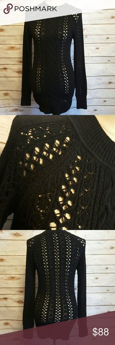 "Free People crochet cable knitt sweater Black Free People sweater in crochet cable knitt. Front has cable knitt design as well as crochet design while back is all crochet design. Banded wrists, neck line, and hem.  Bust- 16"" flat Waist- 15"" flat Length- 31"" Shoulder to cuff- 28"" Stretch material. No fabric tag. Free People Sweaters"