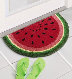 The Watermelon Slice Coir Doormat is a great way to add summertime fun and color to any door and is made with a long lasting vinyl backing.