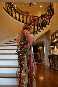 The garland just makes this beautiful staircase stand out! It is full of pretty ribbons and berries. ----This is my dream staircase. Christmas Stairs, Noel Christmas, Winter Christmas, All Things Christmas, Father Christmas, Pink Christmas, Theme Noel, Banisters, Christmas Traditions