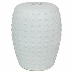 "Offer a stunning seat to guests in your living room or rest your latest read atop this eye-catching ceramic garden stool, showcasing a raised dot design.  Product: Garden stoolConstruction Material: Porcelain and ceramicColor: WhiteFeatures: Raised dot designDimensions: 18.5"" H x 14"" Diameter"