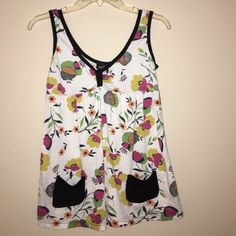 Rue21 Patterned Top This cute Rue 21 top is great for the spring and summer. It's complete with a fitted bust and cute black pockets! Slightly faded but still in overall great condition! Rue 21 Tops Tank Tops