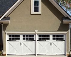 House with Clopay Reserve Collection custom wood carriage style garage doors www.clopay.com