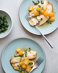 This easy recipe calls for quick-seared tilapia fillets, a little white wine, cherry tomatoes and garlic for a no-fail combination.