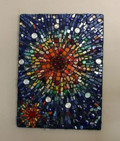 I made this mosaic out of tile, mirror, glass, many glass gems, glitter, and china. It was a fun piece to make and I spend many blissful hours in