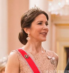 Denmark was represented at this dinner by Crown Princess Mary. She wore her convertible Edwardian Tiara with the new earrings recently created to match the piece. She also secured her sash with her small round diamond brooch.
