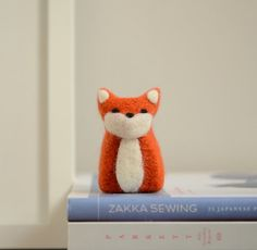 This listing is for 1 needle felted fox. I used 100% wool roving. This sweet fox is perfect for sitting on a mantel, desk, window sill, or just about