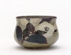 Kenzan-style incense burner with design of camellia  late 18th to early 19th century    Kyoto workshop, Kenzan style   Edo period     Buff clay; white slip, iron and cobalt pigments under transparent glaze; bronze cover.  H: 7.7 W: 10.9 cm   Kyoto, Japan