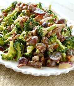 This Broccoli Salad is the best I've ever tried! It's absolutely loaded with yummy flavors. Broccoli, bacon, grapes, dates, and cheese all tossed in an amazing homemade sweet orange dressing that will totally rock your taste buds! Potluck Recipes, Salad Recipes, Cooking Recipes, Healthy Recipes, Potluck Ideas, Potluck Dishes, Healthy Salads, Healthy Options, Delicious Recipes