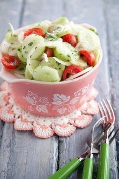 cucumber, tomato, and onion salad - cute way to serve it too - imagine little mini serving dishes for everyone :D