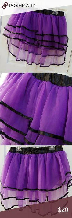 """Purple and black tutu Purple and black tutu. Short and front and longer in back. Measures 13 inches front and 20 inches back. picture number four shows where the black waistband was cut and a small piece of elastic was added to allow longer width of the skirt. waist with elastic from 33 inches up to about 41"""". only worn for one occasion and in like new condition. none Other"""