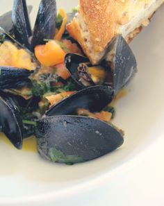 steamed mussels... the big bowl of mussels bathed in white wine, olive ...